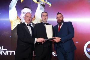 Special recognition award goes to Crossmaglen's Paul Hearty. Paul Hearty is presented with his trophy by Belfast Giant's Matt Nickerson and Robert Cairns, Volvo Parts Manager of category sponsor Volvo. Picture by Kelvin Boyes/ Press Eye