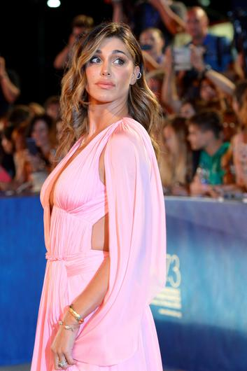 "Argentinian model Belen Rodriguez poses on the red carpet before the premiere of ""Arrival"" presented in competition at the 73rd Venice Film Festival on September 1, 2016 at Venice Lido. / AFP PHOTO / FILIPPO MONTEFORTEFILIPPO MONTEFORTE/AFP/Getty Images"