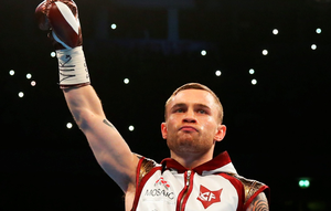 Carl Frampton salutes the crowd prior to the World Super-Bantamweight title contest against  Scott Quigg at Manchester Arena on February 27, 2016 in Manchester, England.  (Photo by Alex Livesey/Getty Images)
