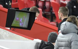 The referee checks the monitor (Peter Powell/PA)