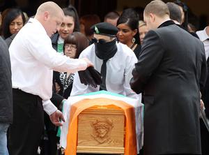 Funeral of dissident Republican Tommy Crossan after he was murdered in west Belfast last week.  The 43-year-old and former senior Continuity IRA figure was gunned down on Good Friday on the Springfield Road.  Relatives and friends carry Mr Crossan's coffin as it leaves St. John the Evangelist Church on the Falls Road surrounded by a colour party.