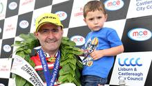 Family ties: Paul Robinson with his son Max celebrates his win at the Ulster Grand Prix