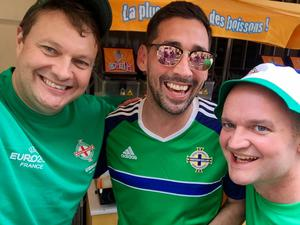 Colin Murray poses with fans in France during the Euros