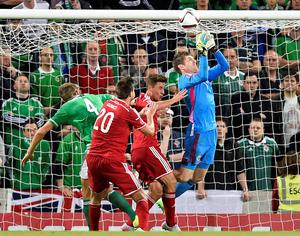 Northern Ireland's goalkeeper Michael McGovern (R) drops the ball leading to Hungary's defender Richard Guzmics (2nd L) scoring the opening goal during the Euro 2016 qualifying group F football match between Northern Ireland and Hungary at Windsor Park in Belfast on September 7, 2015. AFP PHOTO / MICHAEL COOPERMichael Cooper/AFP/Getty Images