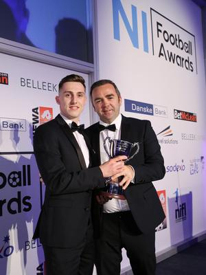 Press Eye - Belfast - Northern Ireland - 7th May 2018  -   NI Football Awards at the Crowne Plaza Hotel.  DREAM SPANISH HOMES YOUNG PLAYER OF THE YEAR  Gerry Flynn makes a presentation to Gavin Whyte, Young Player of the Year  Photo by Kelvin Boyes / Press Eye