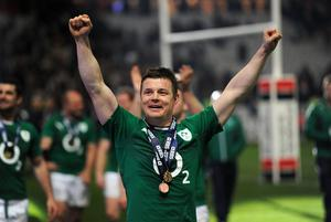 Ireland's Brian O'Driscoll celebrates after the Six Nations match at the Stade de France, Paris, France