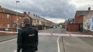 Police at the scene at Etna Drive in the Ardoyne area of Belfast (David Young/PA)