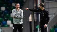 Game plan: Ian Baraclough talks tactics with Damien Johnson at yesterday's Windsor Park training session