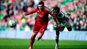 GLASGOW, SCOTLAND - MARCH 01:  Celtic player Efe Ambrose (r) is challenged by Peter Pawlett of Aberdeen during the Scottish Premiership match between Celtic and Aberdeen at Celtic Park Stadium on March 1, 2015 in Glasgow, Scotland.  (Photo by Stu Forster/Getty Images)