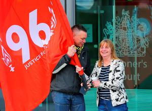WARRINGTON, ENGLAND - APRIL 26:  Margaret Aspinall of the Hillsborough Family Support Group (R) talks with a fellow campaigner as she departs Birchwood Park after hearing the conclusions of the Hillsborough inquest on April 26, 2016 in Warrington, England. The fresh inquests into the 1989 Hillsborough disaster, in which 96 football supporters were crushed to death, concluded on April 26, 2016 with a verdict of unlawful killing, after the initial verdicts were quashed. Relatives of Liverpool supporters who died in Britain's worst sporting disaster gathered in the purpose-built court to hear the jury's verdict in Warrington after a 25 year fight to overturn the accidental death verdicts handed down at the initial 1991 inquiry.  (Photo by Dave Thompson/Getty Images)