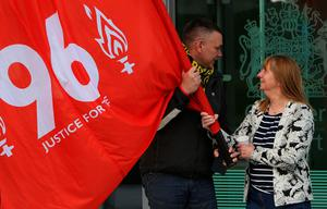 Margaret Aspinall (R), whose son James died in the 1989 Hillsborough disaster, takes hold of a giant banner following the conclusion of the inquest into the 1989 Hillsborough disaster, at the coroner's court in Warrington, north-west England on April 26, 2016. The 96 Liverpool fans who died in Britain's 1989 Hillsborough football stadium disaster were unlawfully killed, a jury found Tuesday following the longest-running inquest in English legal history. After hearing more than two years of evidence, the jury also concluded that the behaviour of Liverpool supporters on the day did not cause or contribute to Britain's worst sports stadium tragedy.  / AFP PHOTO / PAUL ELLISPAUL ELLIS/AFP/Getty Images