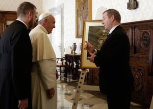 Pope Francis exchanges gifts with Taoiseach Enda Kenny, right, during a private audience in his private studio at the Vatican, Monday, Nov. 28, 2016. (AP Photo/Alessandra Tarantino, pool )