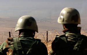 TOPSHOT - A picture taken from the top of Mount Zardak, about 25 kilometres east of Mosul, shows Iraqi Kurdish Peshmerga fighters watching smoke billowing in the Iraqi city of Nineveh, during an operation against Islamic State (IS) group jihadists, on October 17, 2016. Thousands of Iraq's Kurdish peshmerga forces advanced on jihadist-held villages east of Mosul as part of a broad operation to retake the city from the Islamic State group. / AFP PHOTO / SAFIN HAMEDSAFIN HAMED/AFP/Getty Images