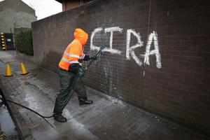 A contractor on the clean up operation in Ballymena after the graffiti attack. Presseye