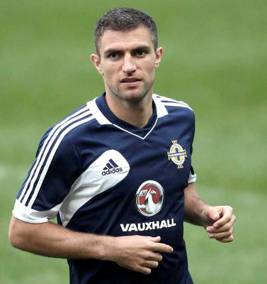On the move: Aaron Hughes knows finding a new club is crucial to his involvement at Euro 2016