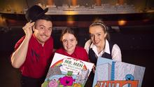 Conor Clarke, Jordan McKee and Ellen Fitzsimmons are photographed celebrating Titanic Belfast being featured in the latest Mr Men book.