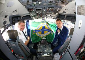 Northern Ireland's captain Steven Davis pictured with airline captain Vladimir Korosec as they leave from George Best Belfast City Airport to take part in a training camp in Austria in advance of the 2016 Euros. Press Eye - Belfast -  Northern Ireland - 30th May 2016 - Photo by William Cherry