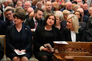 DUP leader Arlene Foster with Sin Fein's Mary Lou McDonald and  Michelle O'Neill before the funeral service for murdered journalist Lyra McKee at St Anne's Cathedral in Belfast.