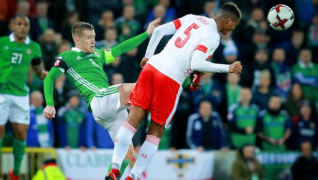 Northern IrelandÕs Steven Davis and Switzerland's Manuel Akanji in action during the World Cup qualifying playoff at Windsor Park on November 9th 2017   (Photo by Kevin Scott / Belfast Telegraph)