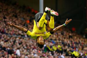 Pierre-Emerick Aubameyang of Borussia Dortmund celebrates scoring his team's second goal during the UEFA Europa League quarter final, second leg match between Liverpool and Borussia Dortmund at Anfield on April 14, 2016 in Liverpool, United Kingdom.  (Photo by Clive Brunskill/Getty Images)