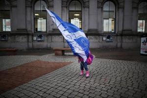 ABERDEEN, SCOTLAND - SEPTEMBER 15: A yes campaigners daughter gets caught up in a Saltire flag on September 15, 2014 in Aberdeen,Scotland. The latest polls in Scotland's independence referendum put the No campaign back in the lead, the first time they have gained ground on the Yes campaign since the start of August.  (Photo by Peter Macdiarmid/Getty Images)