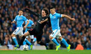 Manchester City's Sergio Aguero (right) and Paris Saint-Germain's Adrien Rabiot battle for the ball during the UEFA Champions League Quarter Final, Second Leg match at the Etihad Stadium, Manchester. Nigel French/PA Wire