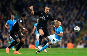 Manchester City's Fernandinho (right) and Paris Saint-Germain's Zlatan Ibrahimovic (left) battle for the ball during the UEFA Champions League Quarter Final, Second Leg match at the Etihad Stadium, Manchester. Nigel French/PA Wire