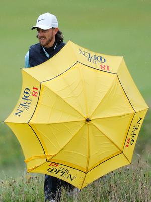 PORTRUSH, NORTHERN IRELAND - JULY 17: Tommy Fleetwood of England shields himself from the rain during a practice round prior to the 148th Open Championship held on the Dunluce Links at Royal Portrush Golf Club on July 17, 2019 in Portrush, United Kingdom. (Photo by Kevin C. Cox/Getty Images)