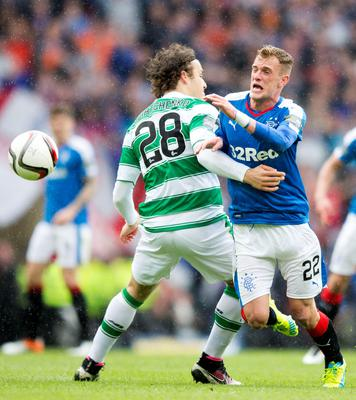 Celtic's Erik Sviatchenko tackles Rangers' Dean Shiels (right) during the William Hill Scottish Cup semi-final match at Hampden Park, Glasgow. PRESS ASSOCIATION Photo. Picture date: Sunday April 17, 2016. See PA story SOCCER Rangers. Photo credit should read: Jeff Holmes/PA Wire. EDITORIAL USE ONLY