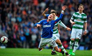 GLASGOW, SCOTLAND - APRIL 17:   Dean Sheils of Rangers goes down under pressure during the William Hill Scottish Cup semi final between Rangers and Celtic at Hampden Park on April 17, 2016 in Glasgow, Scotland.  (Photo by Jeff J Mitchell/Getty Images)
