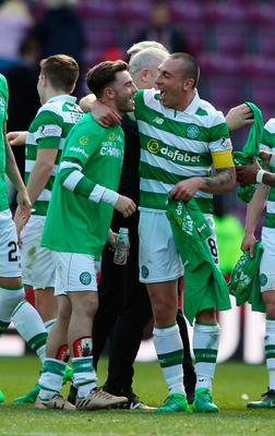 Celtic's Patrick Roberts (left) and Scott Brown celebrate winning the league after the Ladbrokes Scottish Premiership match at Tynecastle Stadium, Edinburgh. PRESS ASSOCIATION Photo. Picture date: Sunday April 2, 2017. See PA story SOCCER Hearts. Photo credit should read: Andrew Milligan/PA Wire. EDITORIAL USE ONLY