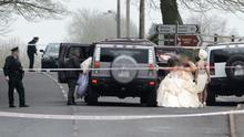 Members of the wedding party leave the church after the shooting this afternoon. Two men have been shot at a wedding in Newtownbutler in County Fermanagh. It happened in the grounds of St Mary's Catholic church shortly after 13:00 GMT. Photo by Ronan McGrade/Pacemaker Press