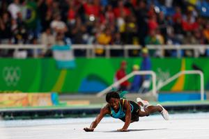 RIO DE JANEIRO, BRAZIL - AUGUST 15:  Shaunae Miller of the Bahamas dives over the finish line to win the gold medal in the Women's 400m Final on Day 10 of the Rio 2016 Olympic Games at the Olympic Stadium on August 15, 2016 in Rio de Janeiro, Brazil.  (Photo by Ian Walton/Getty Images)