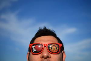 MANCHESTER, ENGLAND - APRIL 01:  A Manchester United fan wears sun shades ahead of  the UEFA Champions League Quarter Final first leg match between Manchester United and FC Bayern Muenchen at Old Trafford on April 1, 2014 in Manchester, England.  (Photo by Michael Regan/Bongarts/Getty Images)
