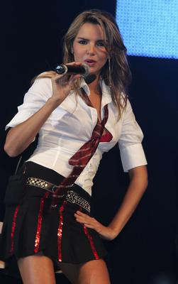 """LONDON - JULY 23: Nadine Coyle of Girls Aloud performs on stage at the second annual """"Big Gay Out"""", Europe's biggest Gay music festival, at Finsbury Park on July 23, 2005 in London, England."""