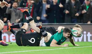 Over the line: Ireland's Jacob Stockdale scores the winning try against the All Blacks in 2018.