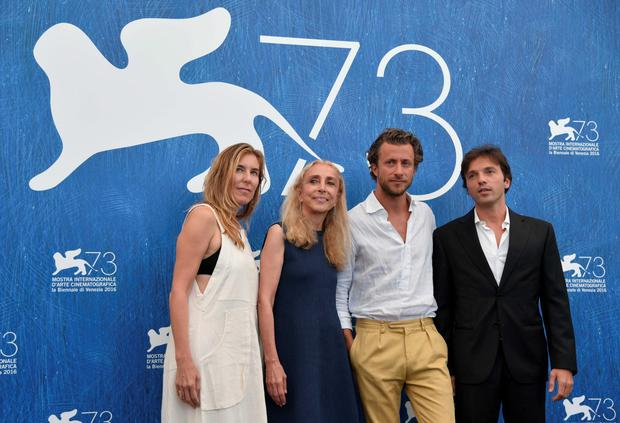 "Fashion editor Franca Sozzani (2ndL) and his son director Francesco Carrozzini (2ndR) pose with producers producer Amy Berg and producer Daniele Di Lorenzo during the photocall of the movie ""Franca : Chaos and Creation"" presented out of competition at the 73rd Venice Film Festival on September 2, 2016 at Venice Lido.TIZIANA FABI/AFP/Getty Images"