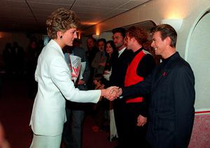 File photo dated 01/12/93 of the Princess of Wales, Patron of the National Aids Trust, shaking hands with pop superstar David Bowie, who has died following an 18-month battle with cancer. PRESS ASSOCIATION Photo. Issue date: Monday January 11, 2016. See PA story DEATH Bowie. Photo credit should read: Martin Keene/PA Wire