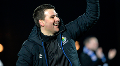 Simply the best: David Healy salutes Linfield's win over Ballymena United last Friday evening