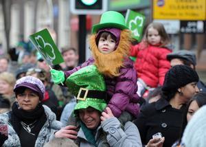 17/3/13 PACEMAKER PRESS INTL. Thousands watch the annual St. Patrick's Day parade from Belfast City Hall as it made it's way to Custom House Square for a festival concert. Picture Charles McQuillan/Pacemaker.