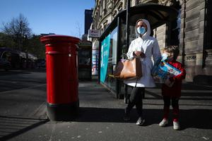 General view of shoppers in Belfast city centre in April as members of the public began to wear face masks in response to Covid-19. Photo by Kelvin Boyes  / Press Eye.