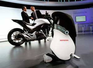 LAS VEGAS, NV - JANUARY 05:  Honda Research & Development President Yoshiyuki Matsumoto (L) and Honda Research & Development Americas President Frank Paluch shake hands as the Honda Riding Assist Motorcycle and Uni-Cub are unveiled at a Honda press event at CES 2017 at the Las Vegas Convention Center on January 5, 2017 in Las Vegas, Nevada. CES, the world's largest annual consumer technology trade show, runs through January 8 and features 3,800 exhibitors showing off their latest products and services to more than 165,000 attendees.  (Photo by David Becker/Getty Images)