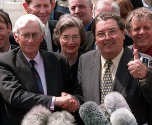 Former SDLP Party  Leader John Hume shakes the hand of Seamus Mallon after he ruled himself out for the post of Second Minister of the new Northern Ireland Assembly and nominated his Deputy Seamus Mallon instead