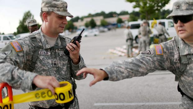 Missouri National Guard troops are deployed to provide protection for a police command centre on August 19, 2014 in Ferguson, Missouri. (Photo by Joe Raedle/Getty Images)