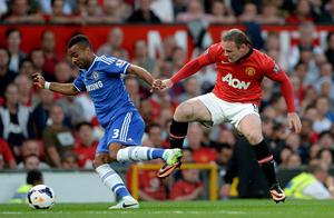 Chelsea's Ashley Cole (left) and Manchester United's Wayne Rooney battle for the ball during the Barclays Premier League match at Old Trafford, Manchester. PRESS ASSOCIATION Photo. Picture date: Monday August 26, 2013. See PA story SOCCER Man Utd. Photo credit should read: Martin Rickett/PA Wire. RESTRICTIONS: Editorial use only. Maximum 45 images during a match. No video emulation or promotion as 'live'. No use in games, competitions, merchandise, betting or single club/player services. No use with unofficial audio, video, data, fixtures or club/league logos.