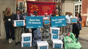 People have been campaigning for the BBC to maintain free TV licences for the over-75s (Alex Green/PA)