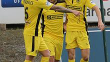 Bright future: Jay Donnelly (right) in Cliftonville's yellow away kit, is hailed after his goal against Portadown