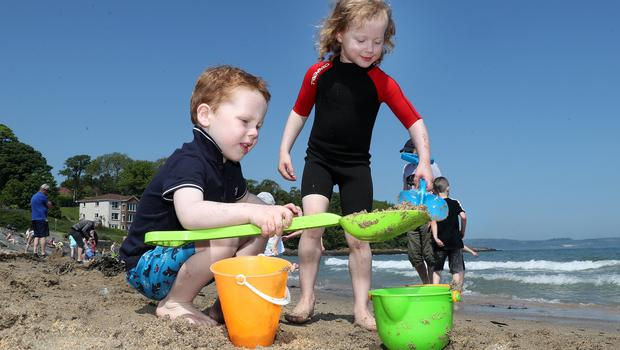 Press Eye - Crawfordsburn Beach - Weather Pictures - 28th May 2018 Photograph by Declan Roughan  PHOTOGRAPH TAKEN WITH PARENTAL PERMISSION  (L-R) Micah Wylie aged 4 from Belfast and Lucy Boucher aged 5 from Antrim.