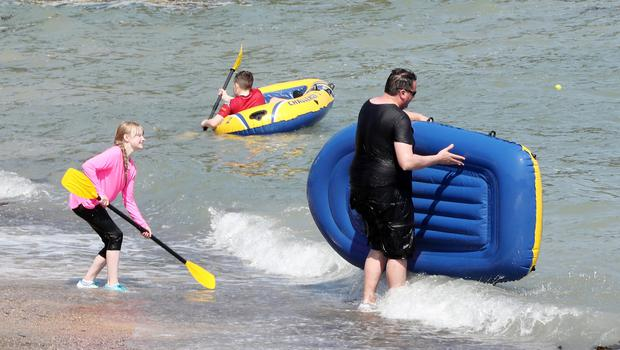 Press Eye - Crawfordsburn Beach - Weather Pictures - 28th May 2018 Photograph by Declan Roughan  PHOTOGRAPH TAKEN WITH PARENTAL PERMISSION  (L-R) Tara Janssen, Matthew Curliss and Desmond King, all from Belfast.