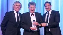 In safe hands: Northern Ireland goalkeeper Michael McGovern was named as the winner of the George Best Breakthrough Award, sponsored by Gym Co. The trophy was presented to his father Terry (centre), by Jim Conlon, Director of Gym Co and Northern Ireland goalkeeping legend Pat Jennings.